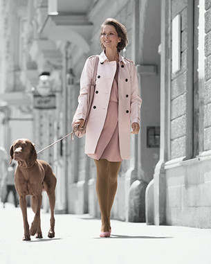women with dog on street