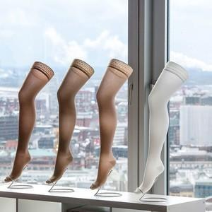 Compression stockings against a skyline background