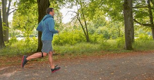 A man jogging in the woods