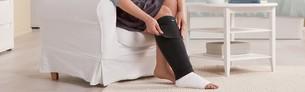 Woman putting a Juzo ACS on her leg