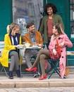 Kvinna med Juzo Soft-strumpa på resa med sin affärspartner