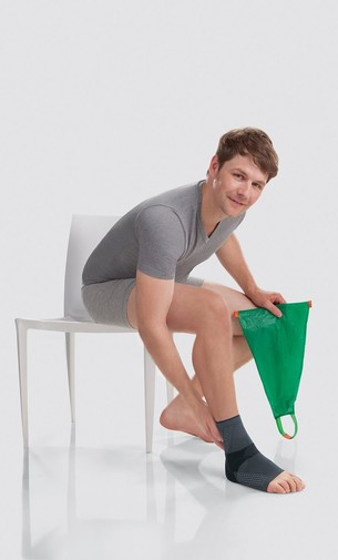 Man using donning aid