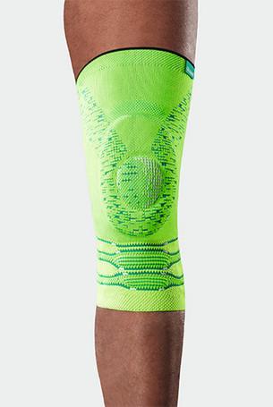 Knie met de Genu Xtra Style in Glowing Green