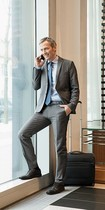 Business man making a call wearing travel compression stockings