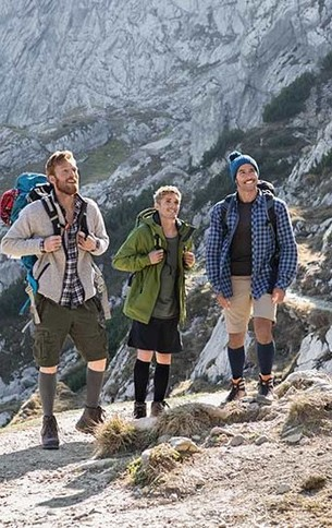 Three hiking men are wearing Juzo Products