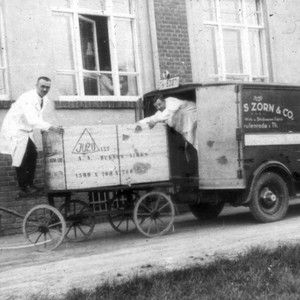 Historical image with delivery truck